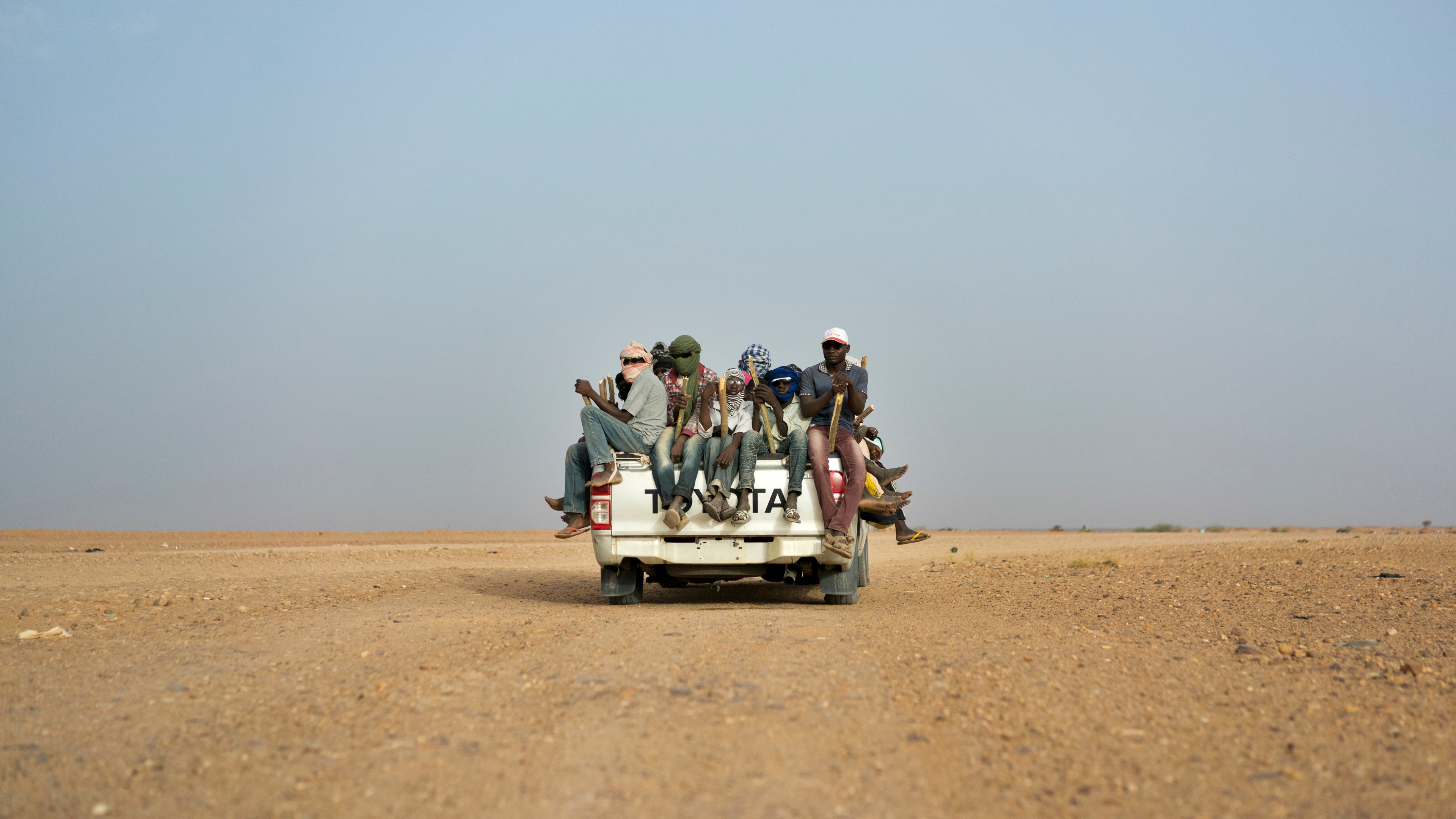 In this Monday, June 4, 2018 file photo, Nigeriens and third-country migrants head towards Libya from Agadez, Niger.