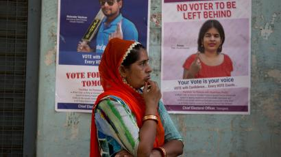 An Indian women stand outside a polling booth to cast her vote in Hyderabad, India,