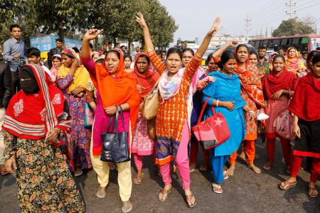 Bangladeshi garment workers shout slogans during a protest in Savar, on the outskirts of Dhaka, Bangladesh, Wednesday, Jan. 9, 2019. Thousands of garment workers have staged demonstrations to demand better wages for the fourth straight day, shutting down factories on the outskirts of Bangladesh's capital. Bangladesh has the second-largest garment-export industry in the world after China and makes clothes for big-name retailers. (AP Photo)