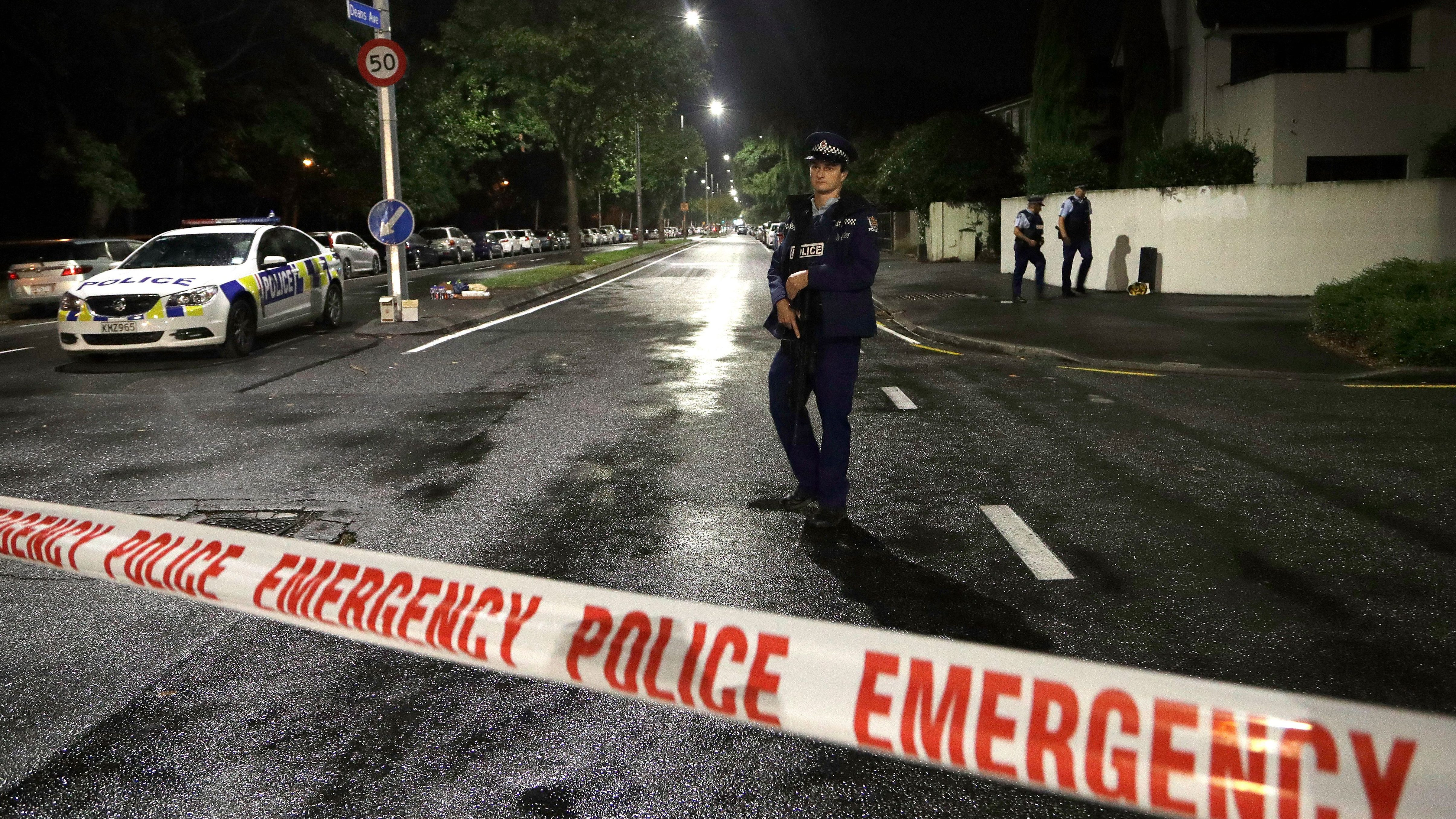 A police officer patrols at a cordon near a mosque in central Christchurch, New Zealand, Friday, March 15, 2019.
