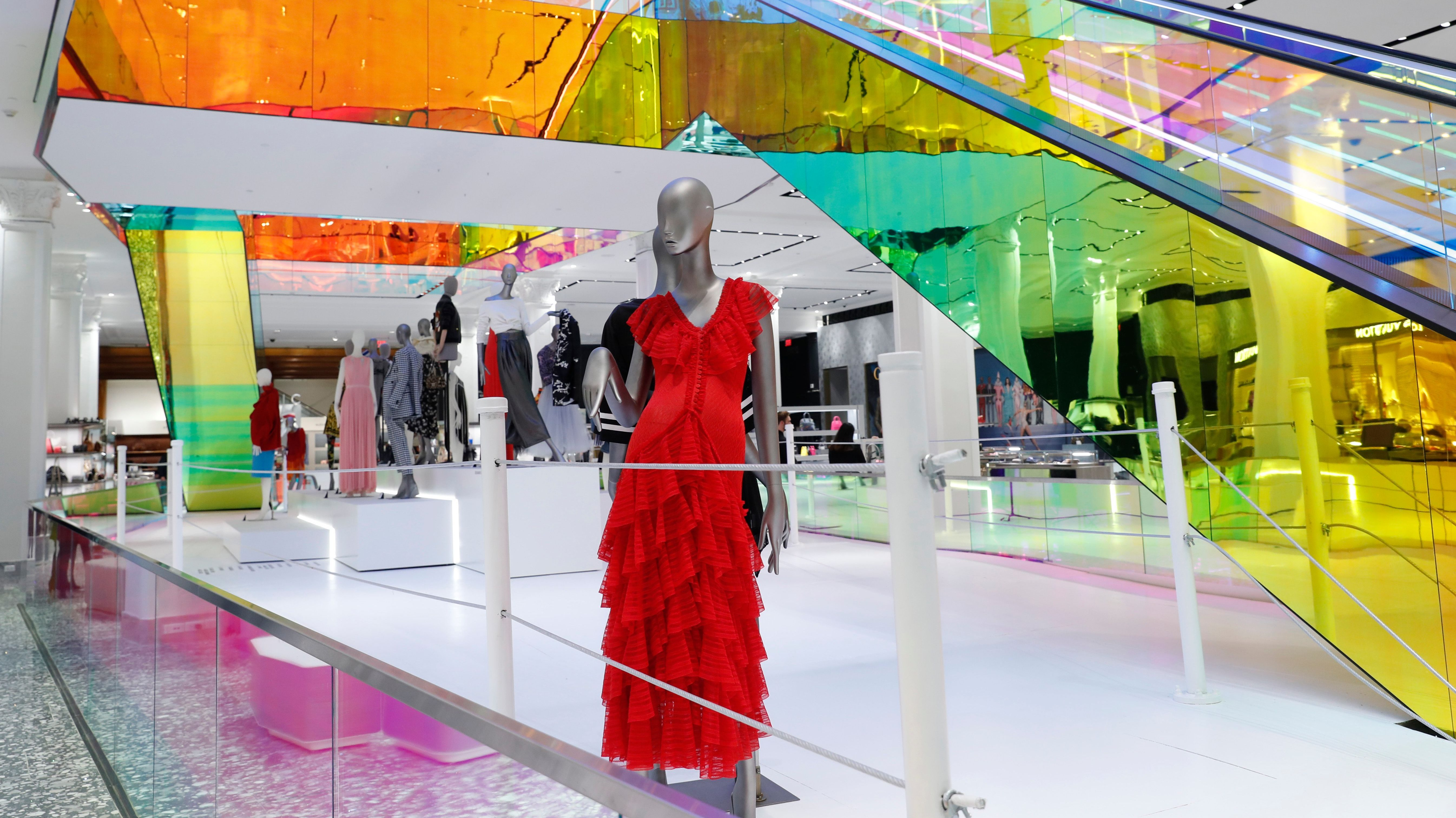 A mannequin wears a red dress inside the Saks Fifth Avenue's flagship midtown Manhattan store, Wednesday, Feb. 20, 2019, in New York. (AP Photo/Kathy Willens)