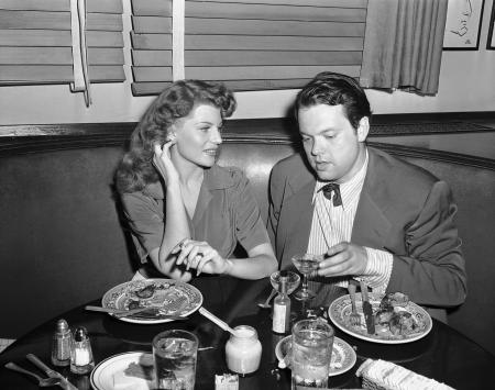 Movie Star Rita Hayworth and actor director Orson Welles, dining at the Hollywood Brown Derby, August 12, 1943, are partners in a Magic Tent Show put on for the Benefit of service men. (AP Photo)