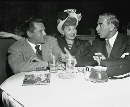 Eddie Cantor, right, talks with comedienne Lucille Ball, center, and her husband Desi Arnaz during dinner at Los Angeles' Brown Derby, Oct. 10, 1946. (AP Photo)