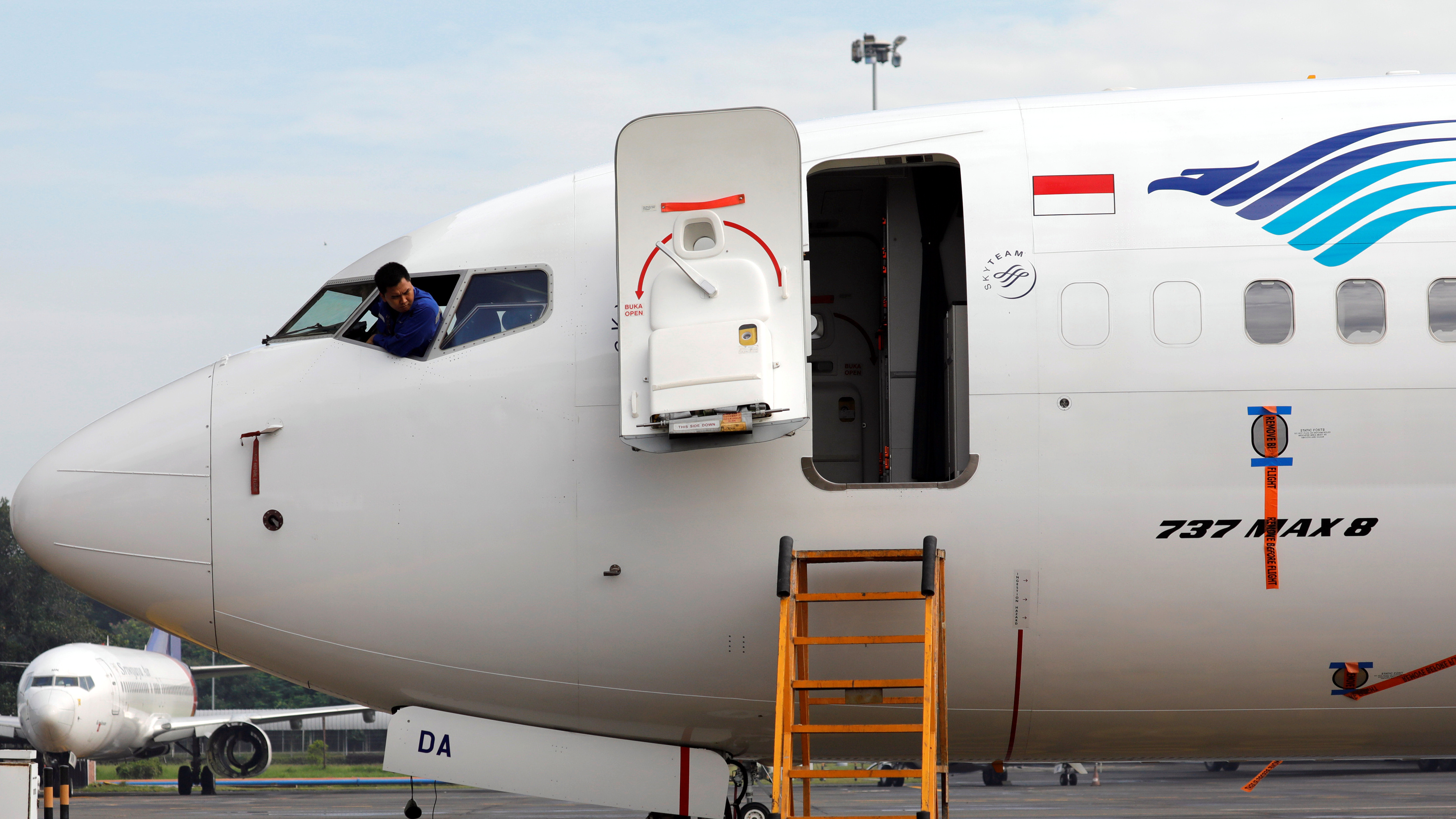 A technician looks out from the window as he checks Garuda Indonesia's Boeing 737 Max 8 airplane, that parked at the Garuda Maintenance Facility AeroAsia, at Soekarno-Hatta International airport near Jakarta, Indonesia, March 13, 2019.