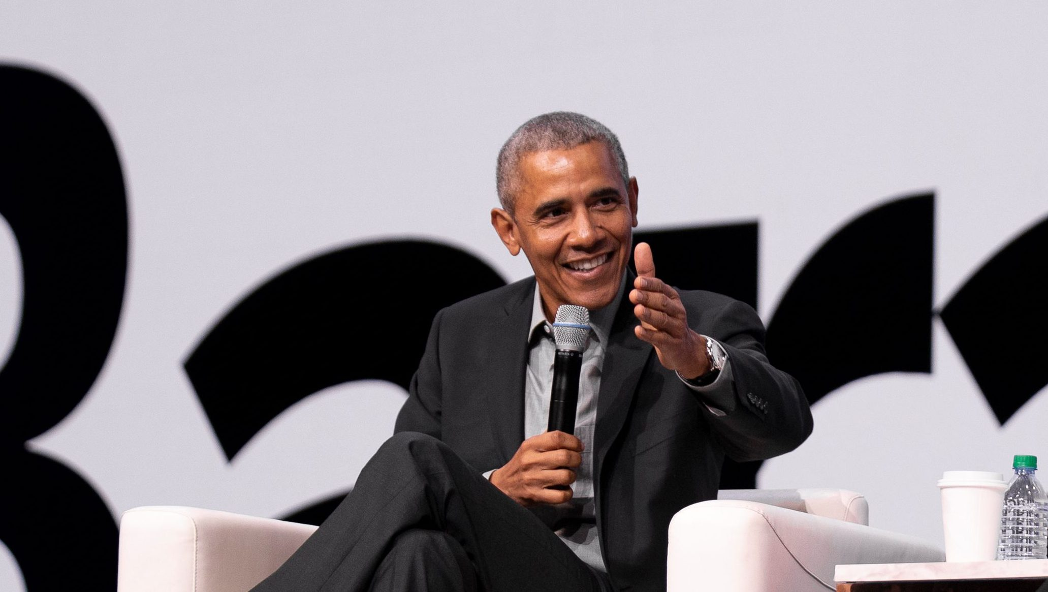 Former president Barack Obama speaks to Qualtrics CEO Ryan Smith at Qualtrics X4 Experience Summit in Salt Lake City, 2019.