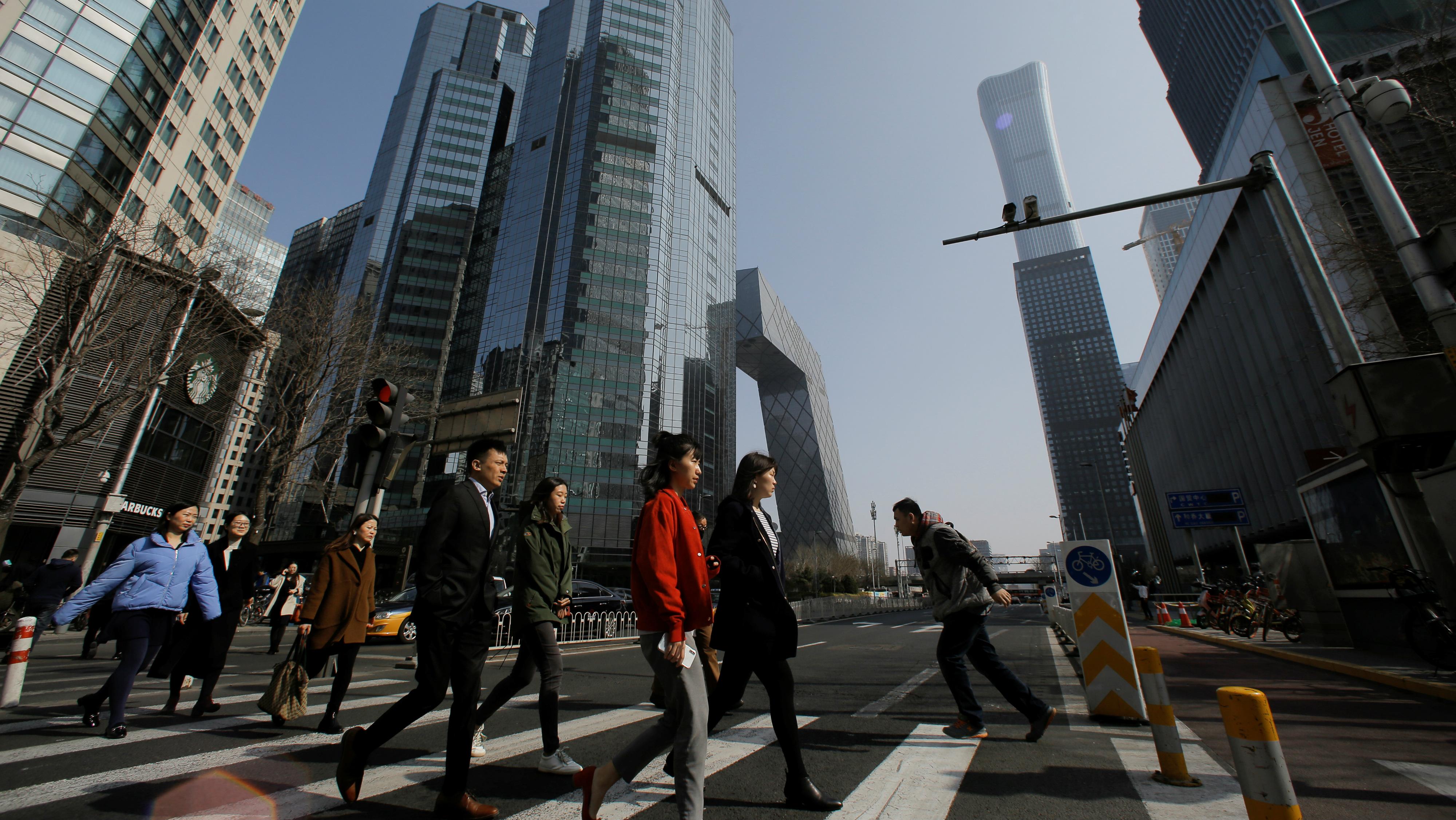 People walking on a street in Beijing, China.