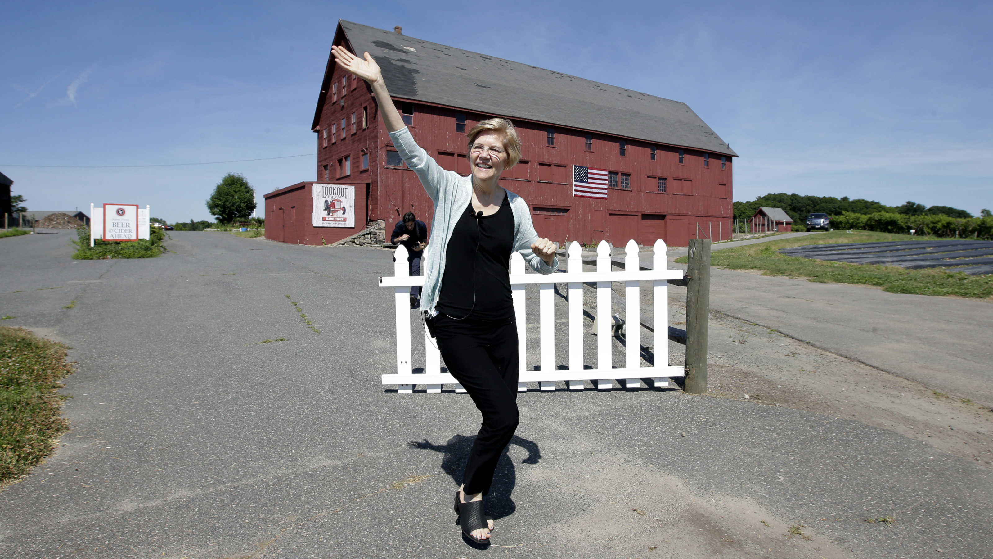 Sen. Elizabeth Warren, D-Mass., waves as she arrives at Belkin Family Lookout Farm before a town hall event, Sunday, July 8, 2018, in Natick, Mass. Warren is hosting the town hall and cookout following an Independence Day trip to visit U.S. troops in Iraq and Kuwait.