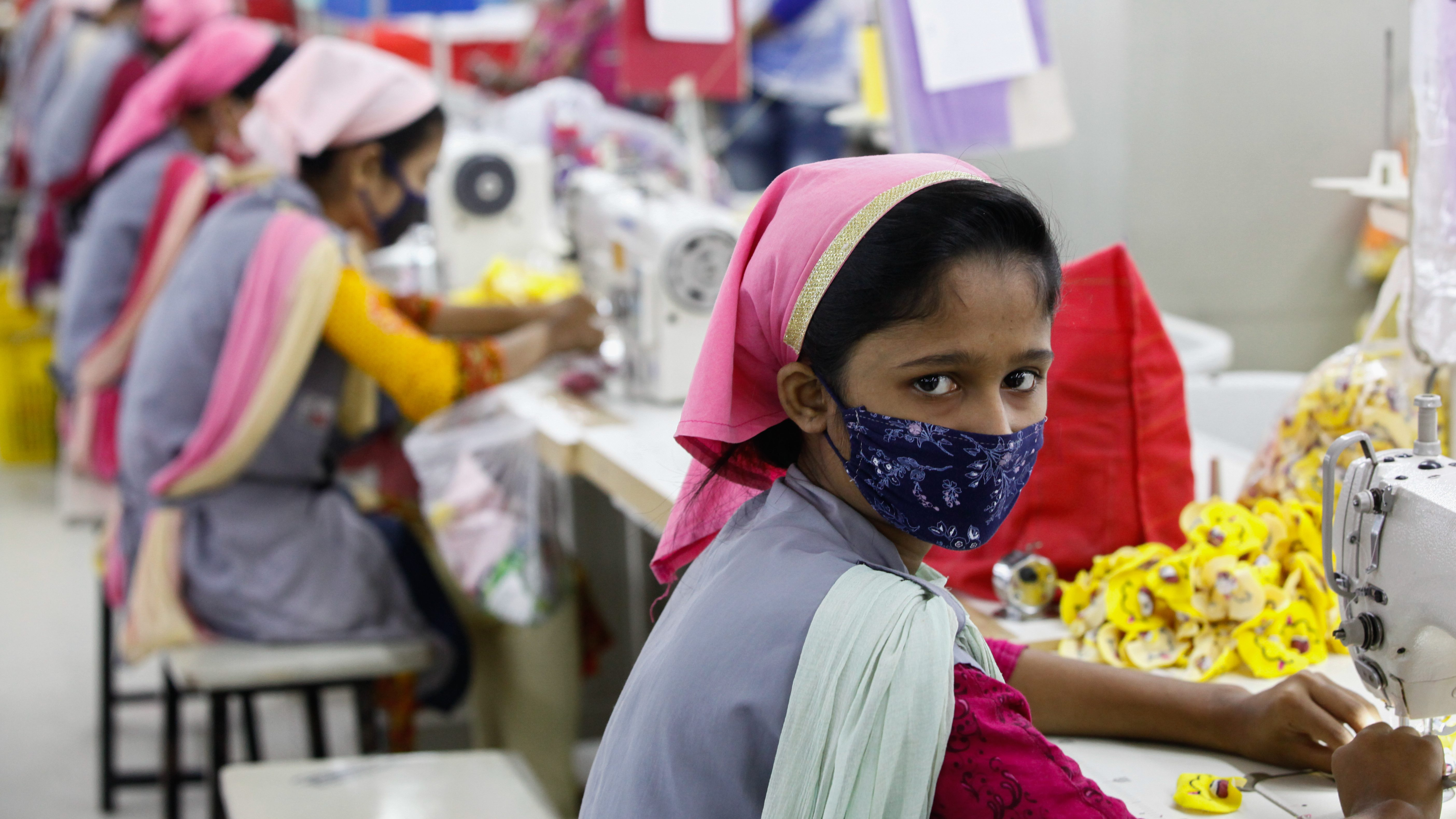 Bangladeshi female workers work at a garments factory in Gazipur outskirts of Dhaka on February 17, 2018. The garment sector has provided employment opportunities to women from the rural areas that previously did not have any opportunity to be part of the formal workforce. This has given women the chance to be financially independent and have a voice in the family because now they contribute financially.However, women workers face problems. Most women come from low income families. Low wage of women workers and their compliance have enabled the industry to compete with the world market.The textile and clothing industries provide the single source of growth in Bangladesh's rapidly developing economy. Exports of textiles and garments are the principal source of foreign exchange earnings. Bangladesh is the world's second-largest apparel exporter of western (fast) fashion brands. Sixty percent of the export contracts of western brands are with European buyers and about forty percent with American buyers. (Photo by Mehedi Hasan/NurPhoto via Getty Images)