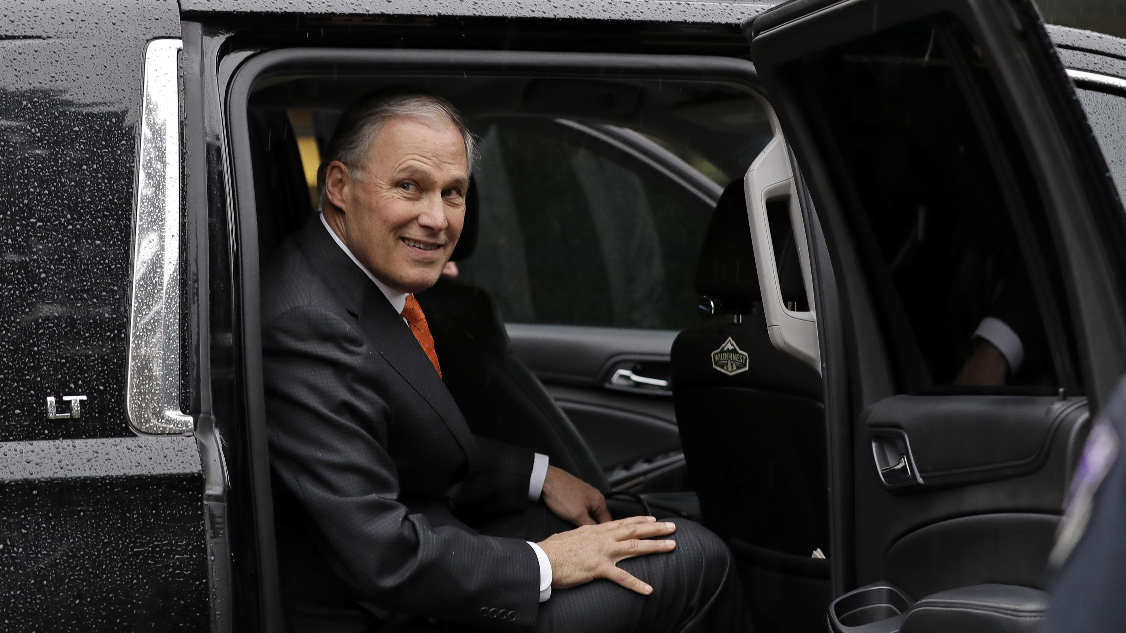 """Washington Gov. Jay Inslee gets into an SUV after speaking Wednesday, March 6, 2019, on at non-partisan panel discussion titled """"Foreign Affairs and National Security in the Age of Climate Change"""" hosted by the University of Washington Jackson School and the American Security Project on the UW campus in Seattle. Inslee announced last week that he would be seeking the Democratic nomination for President."""