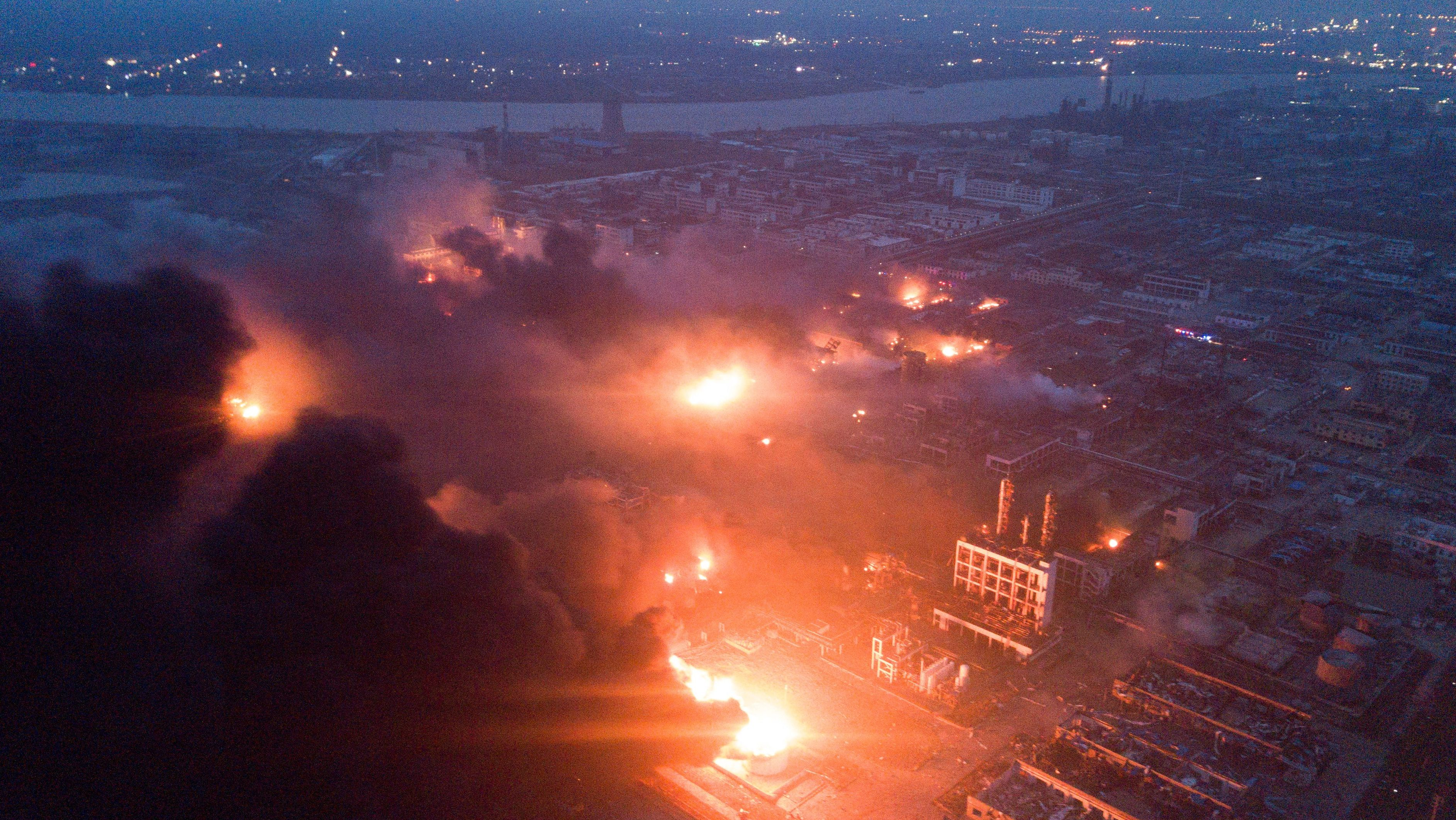 Smoke billows from fire following an explosion at the pesticide plant owned by Tianjiayi Chemical, in Xiangshui county, Yancheng, Jiangsu province, China March 21, 2019. Picture taken March 21, 2019.