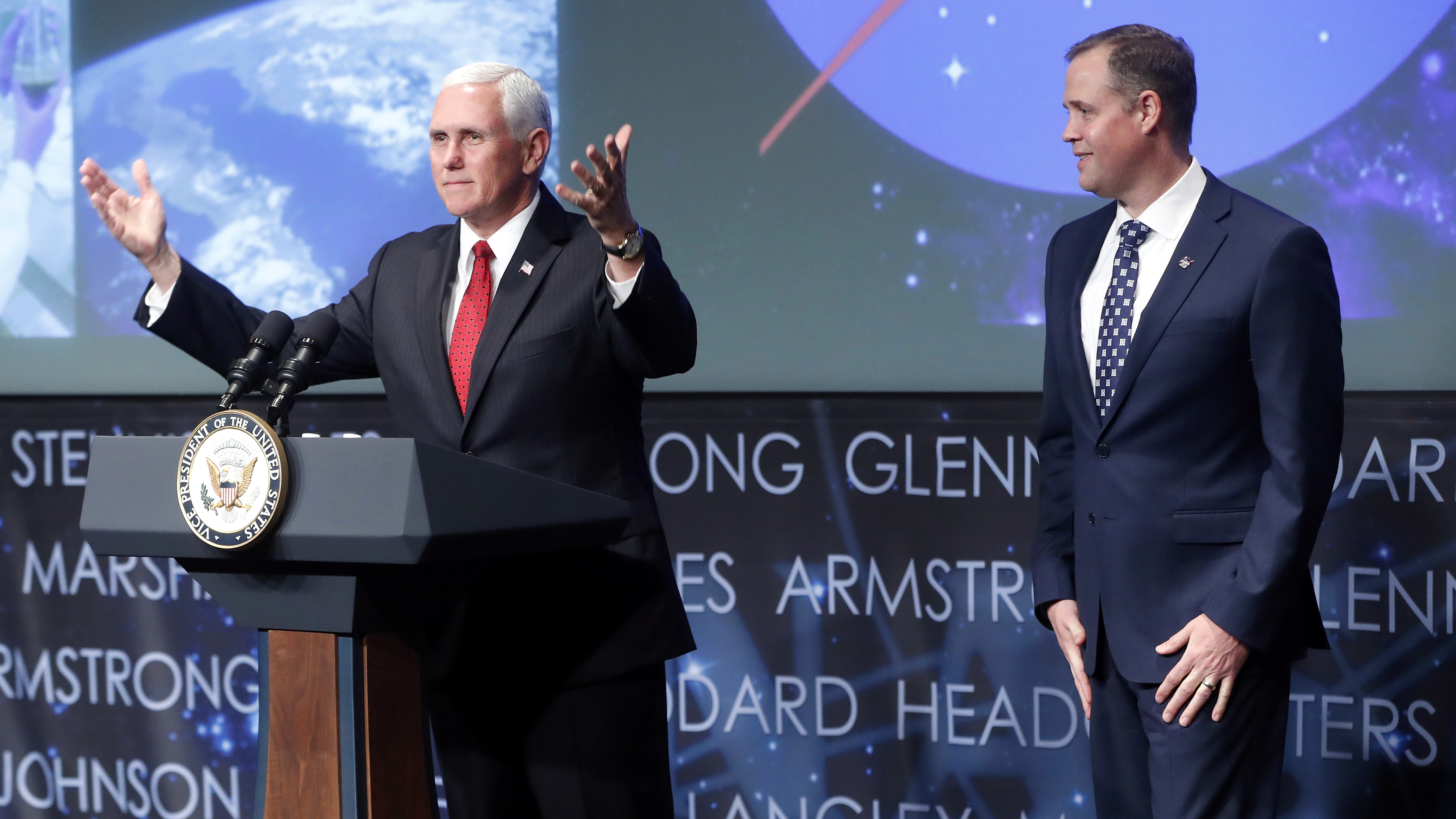 Vice President Mike Pence, left, gestures while speaking during the swearing-in ceremony for Jim Bridenstine, right, as the Administration of the National Aeronautics and Space Administration (NASA) during a ceremony, Monday, April 23, 2018, at NASA Headquarters in Washington.