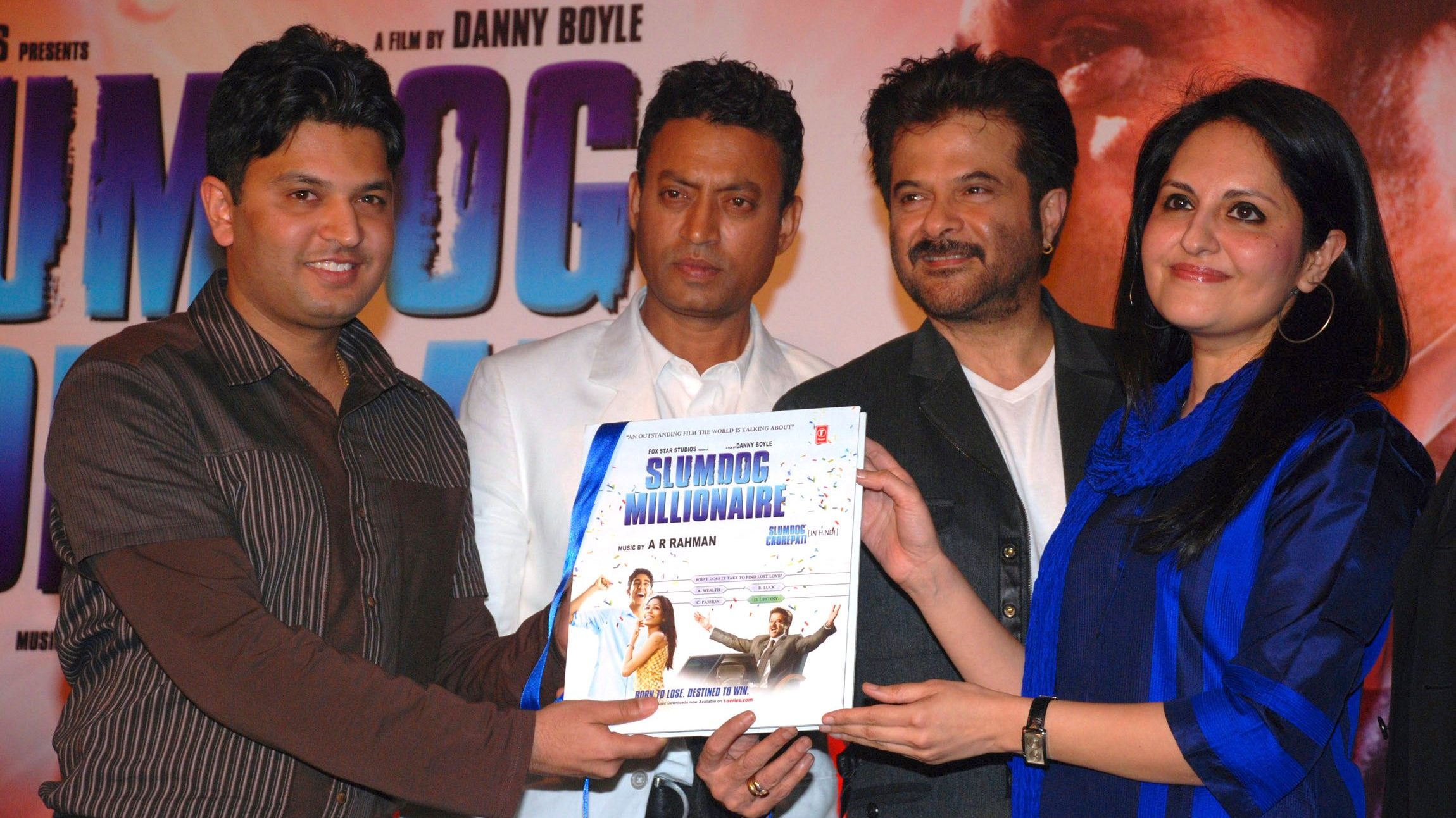 "Music company T-series MD Kumar, Bollywood actors Khan, Kapoor and co-director Tandan pose with music album of ""Slumdog Millionaire"" in Mumbai"