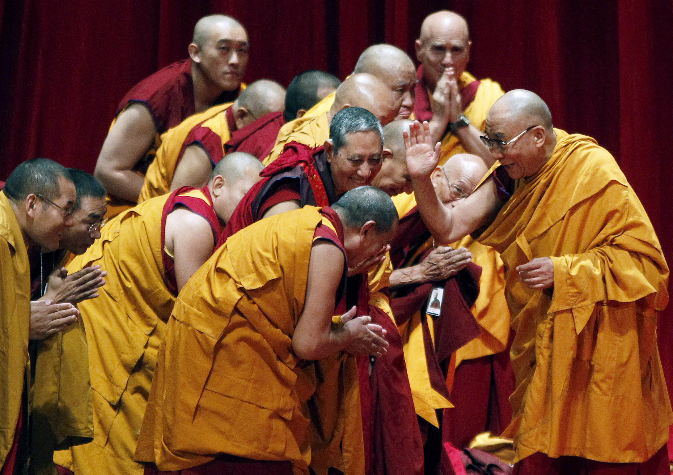 The Dalai Lama greets Buddhist monks before a teaching session at Radio City Music Hall in New York on May 20, 2010.