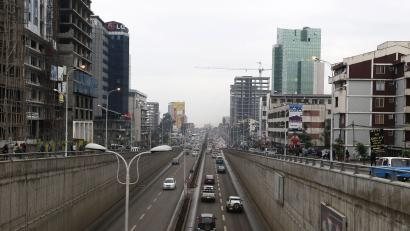 Cars drive out of an underpass in Addis Ababa May 26, 2014. Ethiopia has pushed the door ajar for foreign retailers keen to enter the fast-growing market of 90 million people, welcoming them as managers but keeping the state in control. To match story ETHIOPIA-RETAIL/