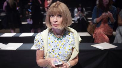 Vogue editor Anna Wintour sits in her seat before the Donna Karan Spring/Summer 2015 collection show during New York Fashion Week in the Manhattan borough of New York September 8, 2014. REUTERS/Carlo Allegri (UNITED STATES - Tags: FASHION ENTERTAINMENT) - GM1EA990KPG01