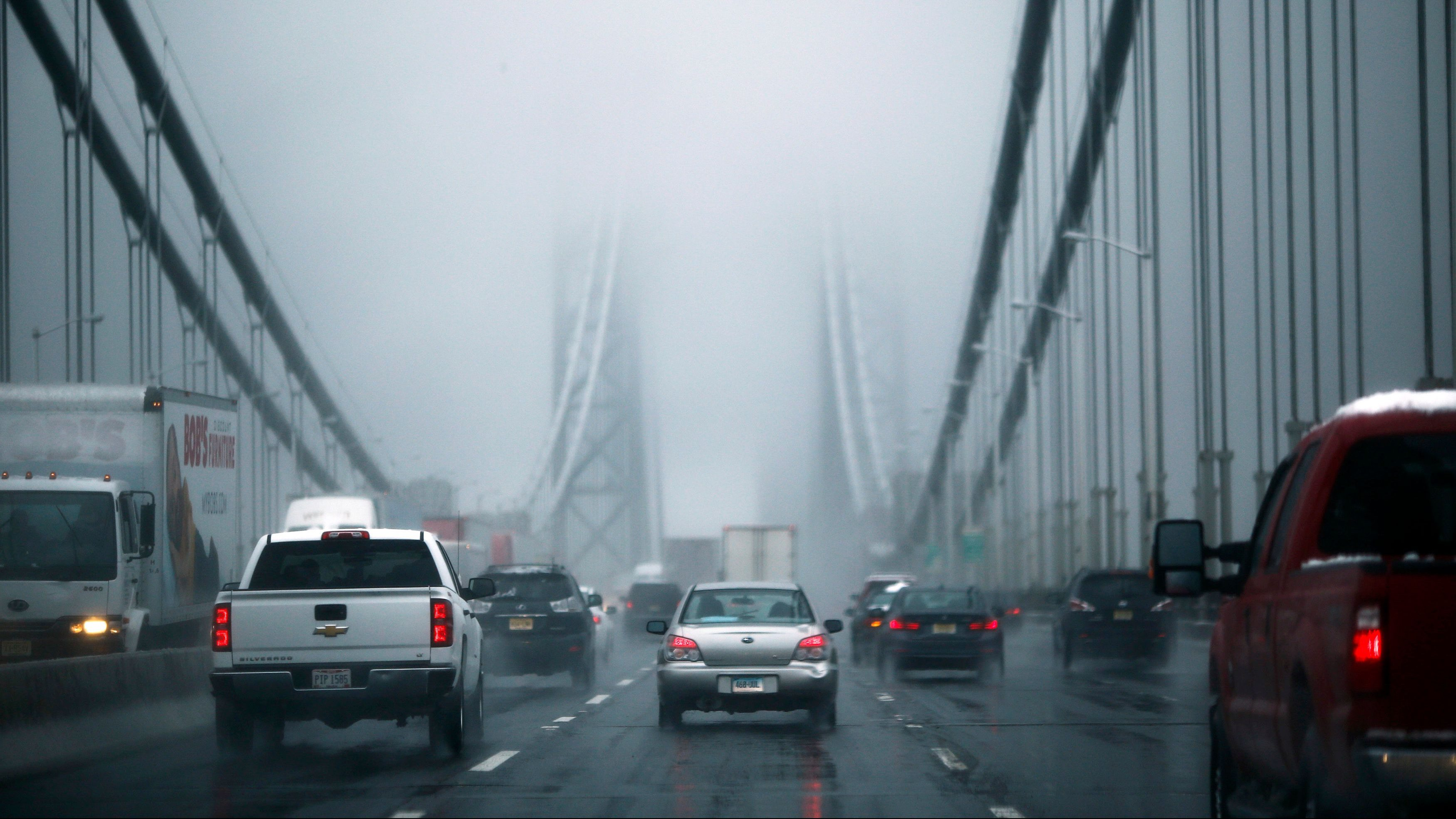 Cars make their way through the Washington bridge in New York