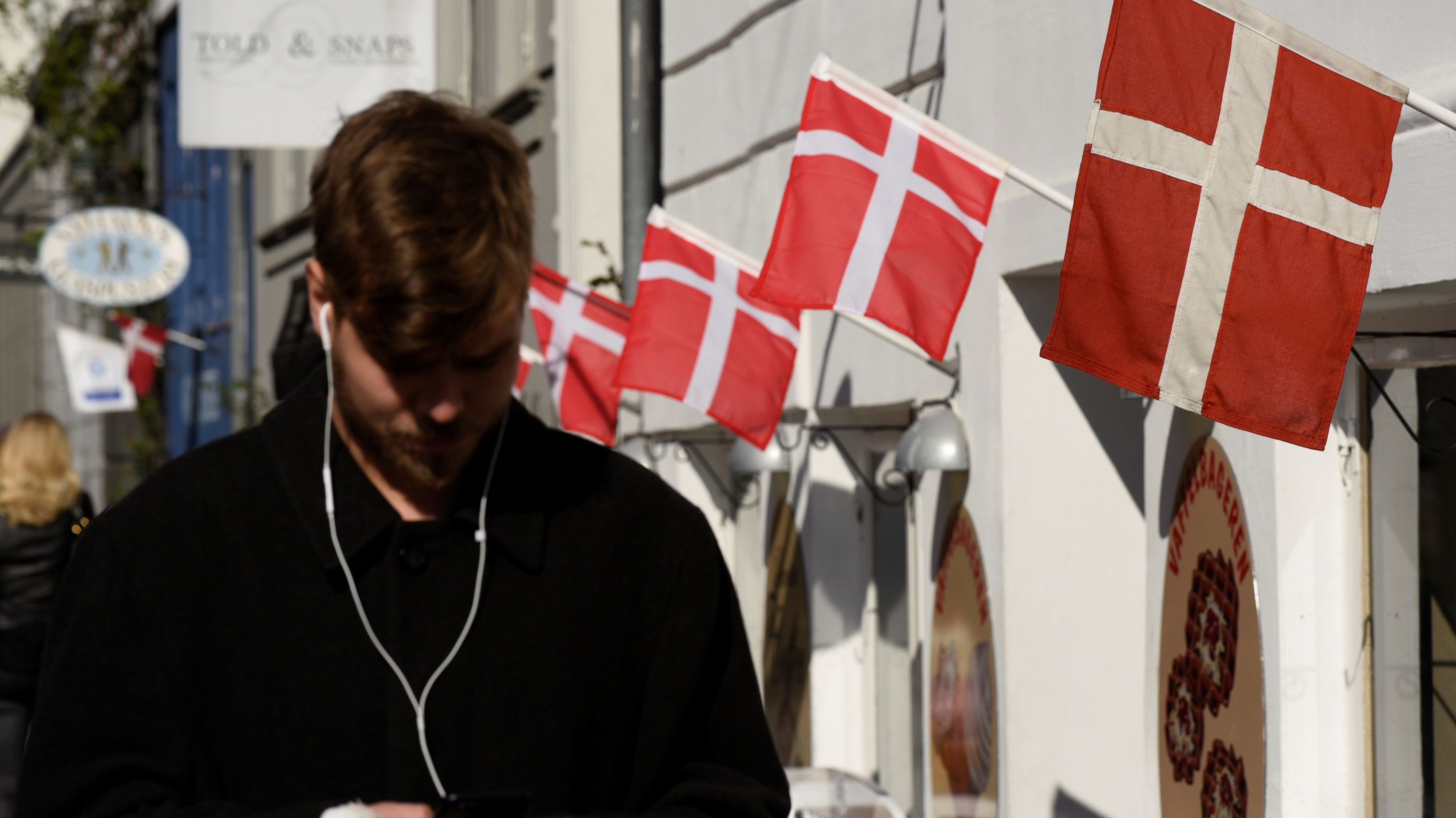 Danish flags are pictured outside a cafe at the famous landmark Nyhavn in Copenhagen
