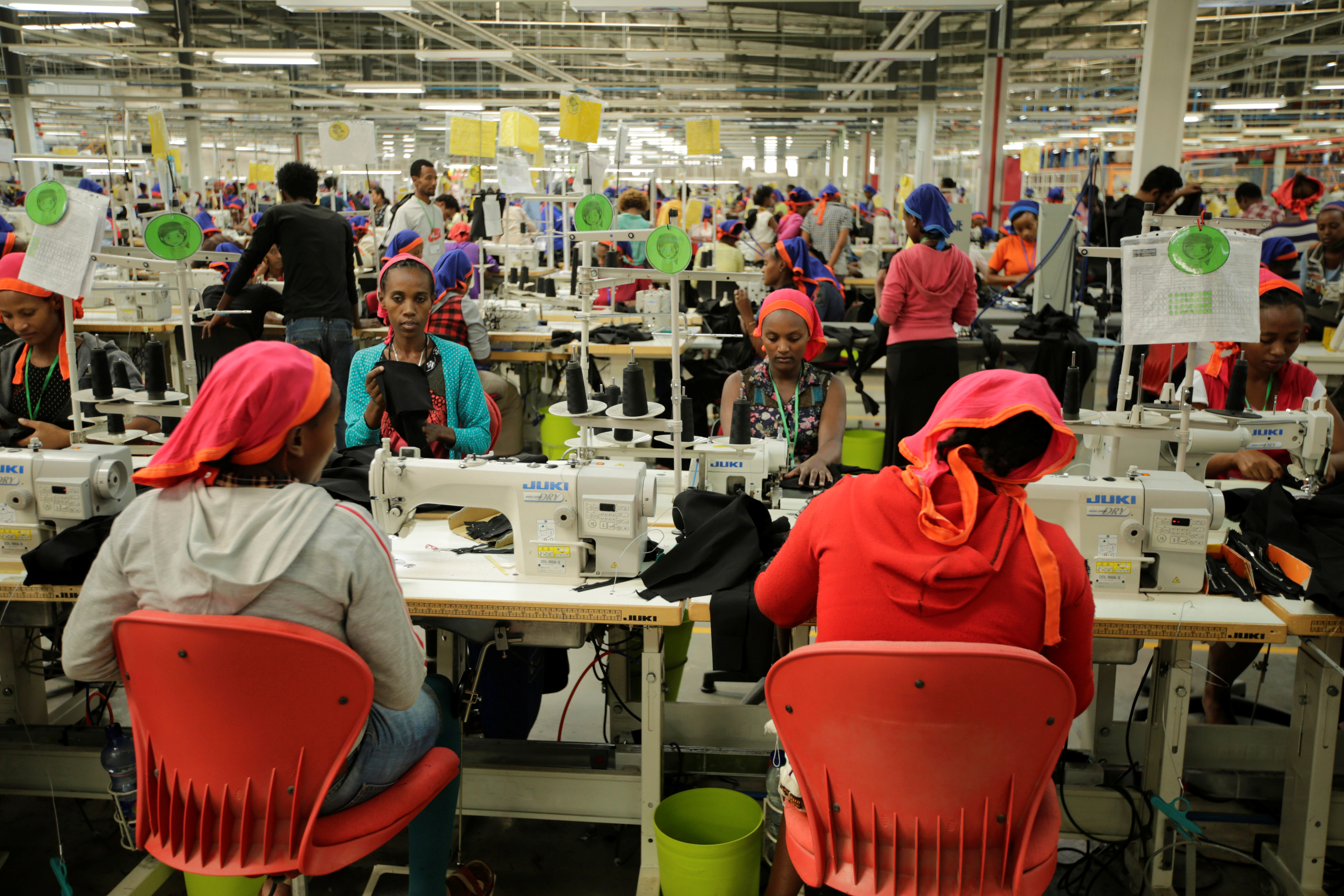 Workers sew clothes inside the Indochine Apparel PLC textile factory in Hawassa Industrial Park in Southern Nations, Nationalities and Peoples region, Ethiopia November 17, 2017. Picture taken November 17, 2017.REUTERS/Tiksa Negeri - RC17B0E7FE80