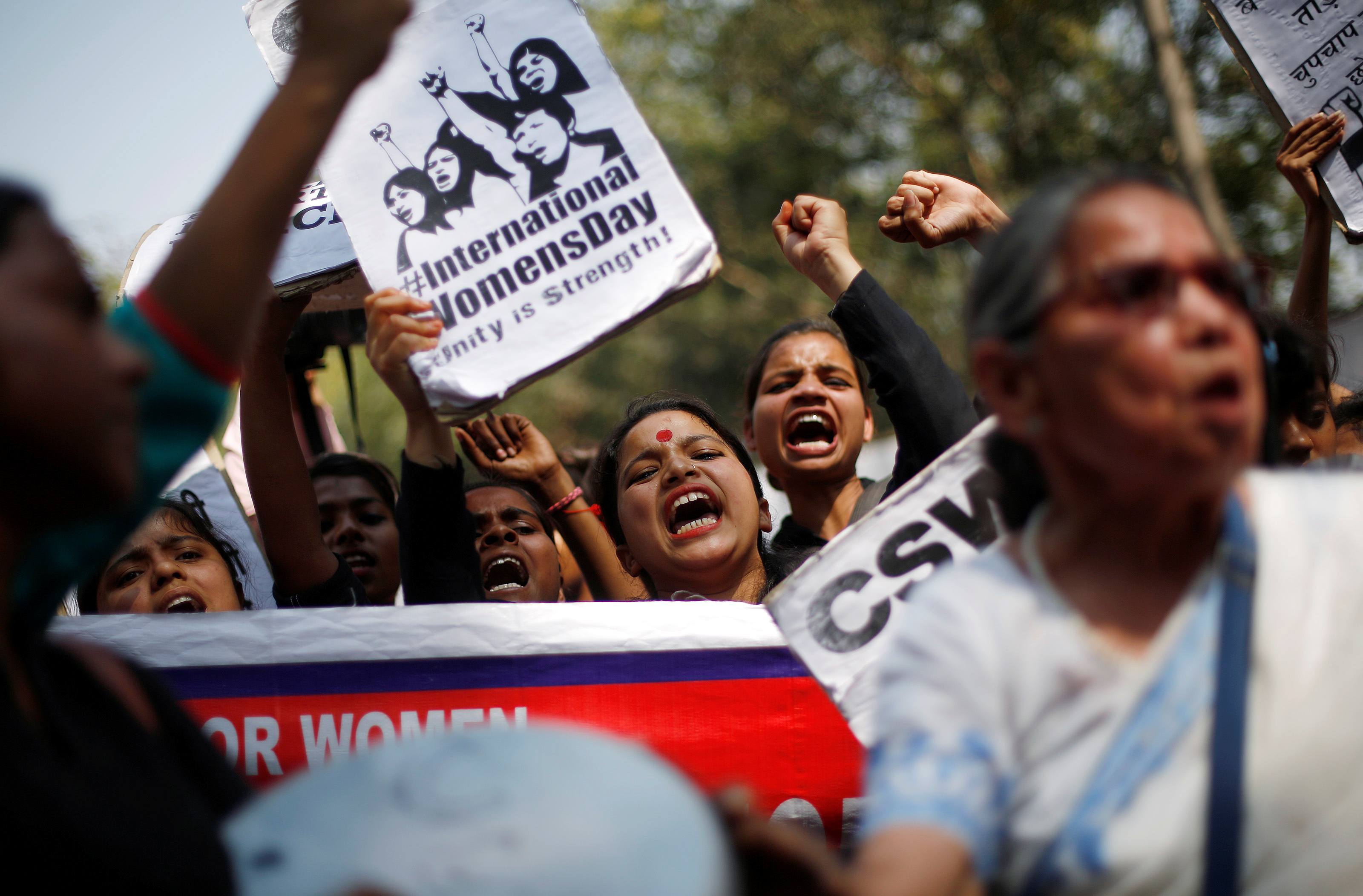 Girls shout slogans during a protest demanding equal rights for women on the occasion of International Women's Day in New Delhi