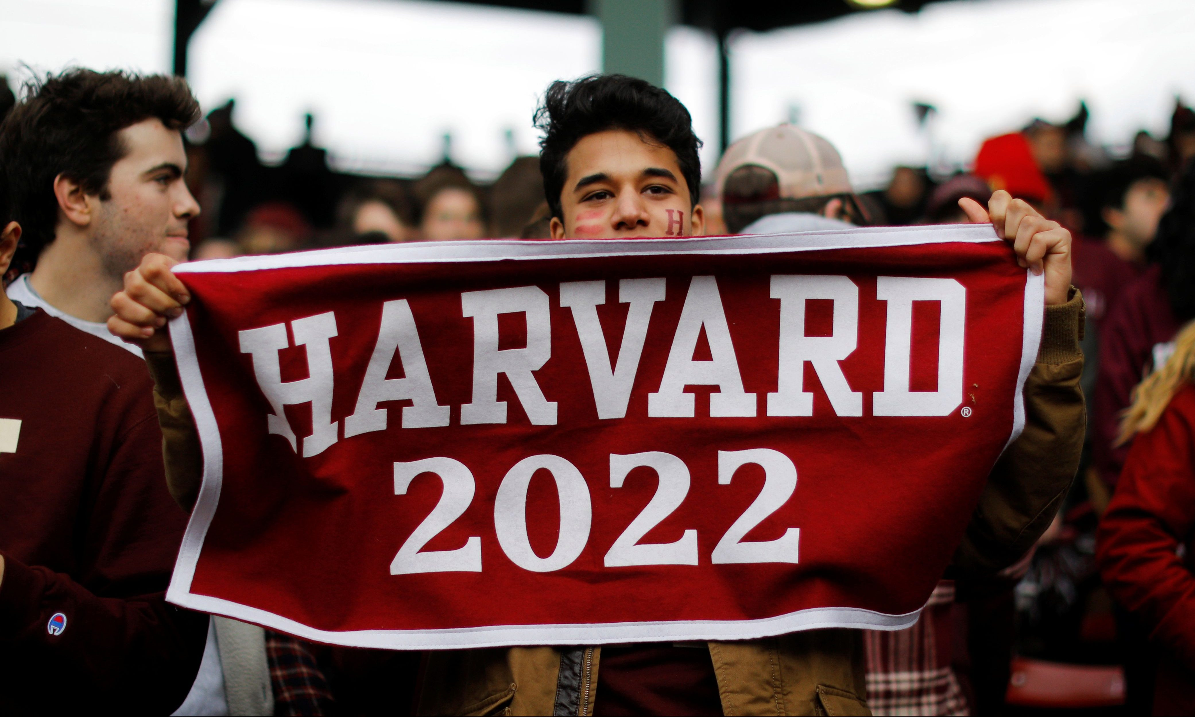 """A Harvard University student cheers during the 135th playing of """"The Game"""" against Yale University, at Fenway Park in Boston, Massachusetts, U.S., November 17, 2018. REUTERS/Brian Snyder - RC140C5D1500"""
