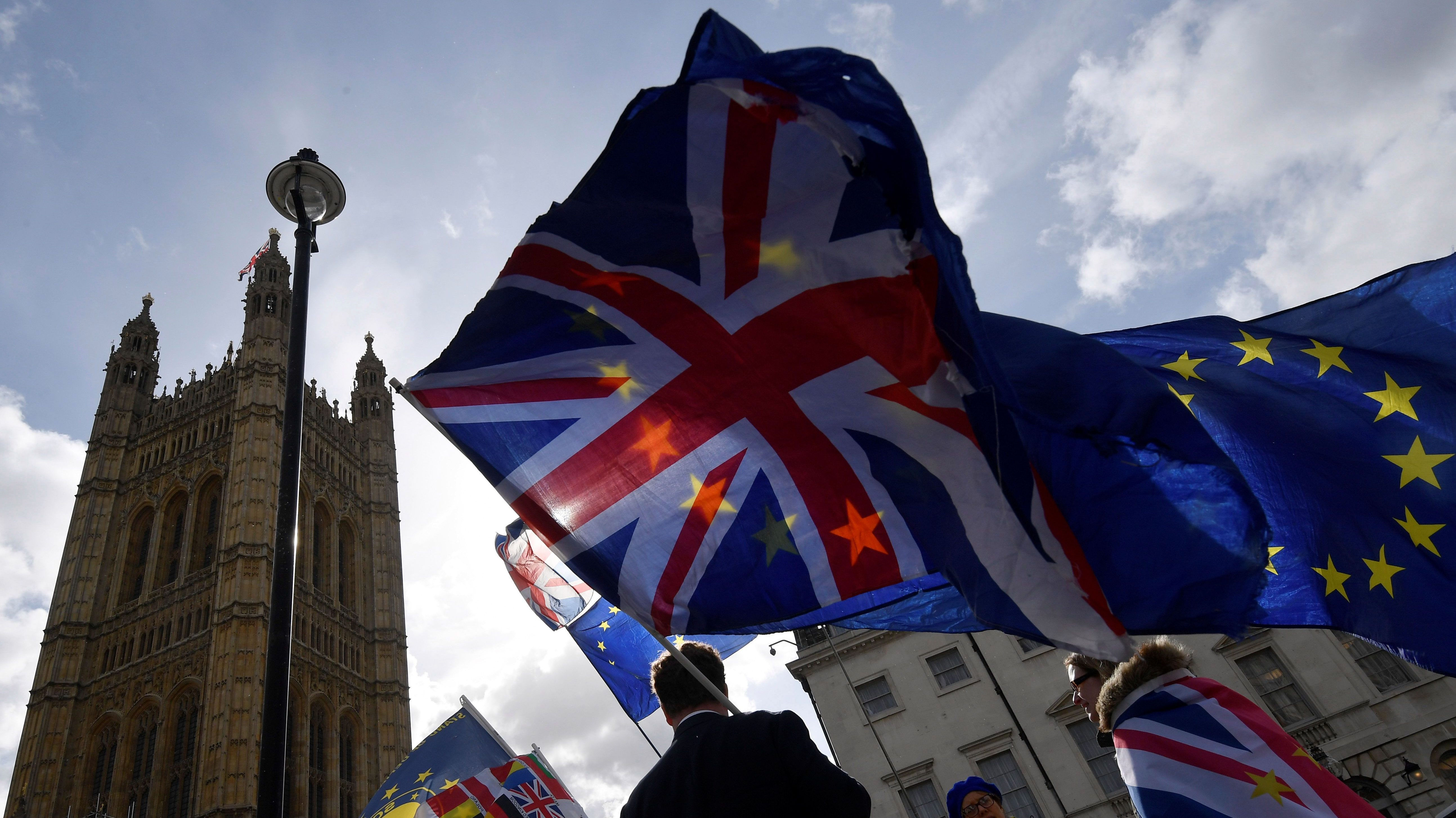 Anti-Brexit protesters gather opposite the Houses of Parliament