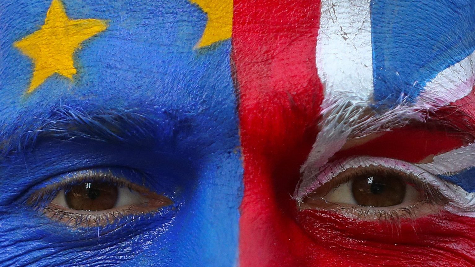 An anti-Brexit protester with painted EU and British flags on his face is seen ahead of a EU Summit in front of European Commission headquarters in Brussels, Belgium March 21, 2019.