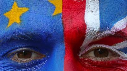 An anti-Brexit protester with painted EU and British flags on his face is seen ahead of a EU Summit in front of European Commission headquarters in Brussels