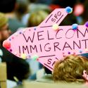 Demonstrators hold welcome signs for immigrants during second day of anti-Donald Trump immigration ban protests inside Terminal 4 at San Francisco International Airport in San Francisco