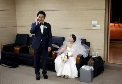 A bridal couple gets ready for their wedding ceremony at a budget wedding hall at the National Library of Korea in Seoul, South Korea.