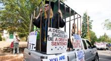 Parade participants protesting against high student loan burdens