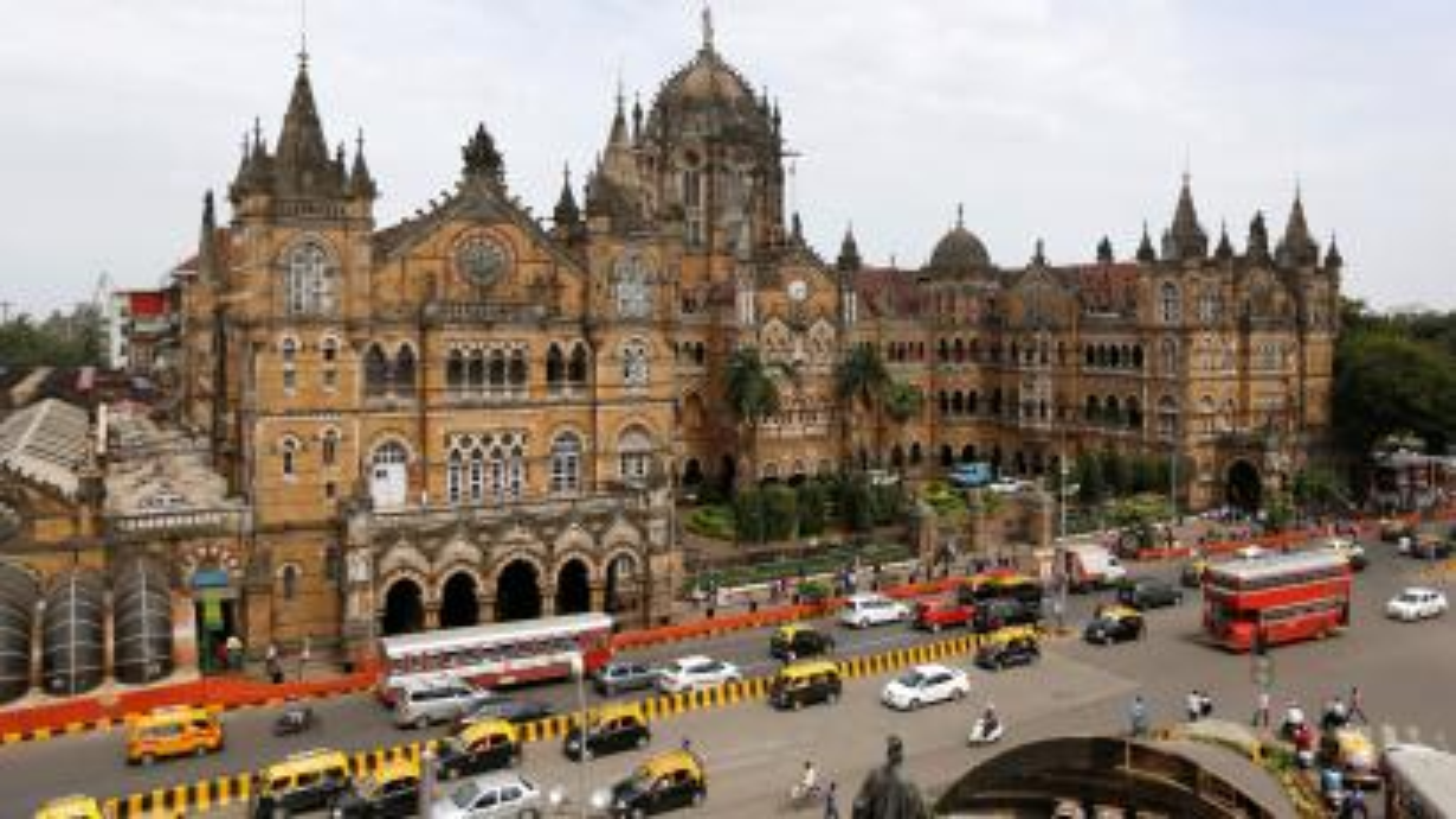 Traffic moves in front of the Chhatrapati Shivaji Terminus railway station in Mumbai