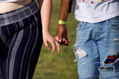 A couple holds hands