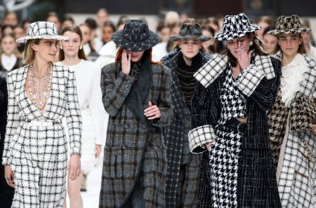 Cara Delevingne and other models react while presenting creations by late designer Karl Lagerfeld as part of his Fall/Winter 2019-2020 women's ready-to-wear collection show for fashion house Chanel at the Grand Palais during Paris Fashion Week in Paris, France March 5, 2019. REUTERS/Regis Duvignau - RC16CF484BB0