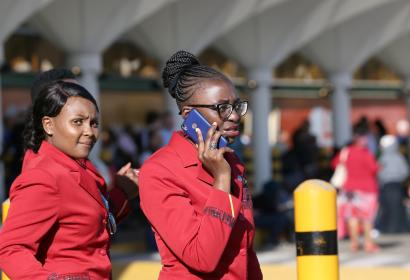 A Kenya Airways flight attendant uses her cell phone as they gather at the Jomo Kenyatta International Airport during a labour dispute that grounded flights near Nairobi, Kenya March 6, 2019.