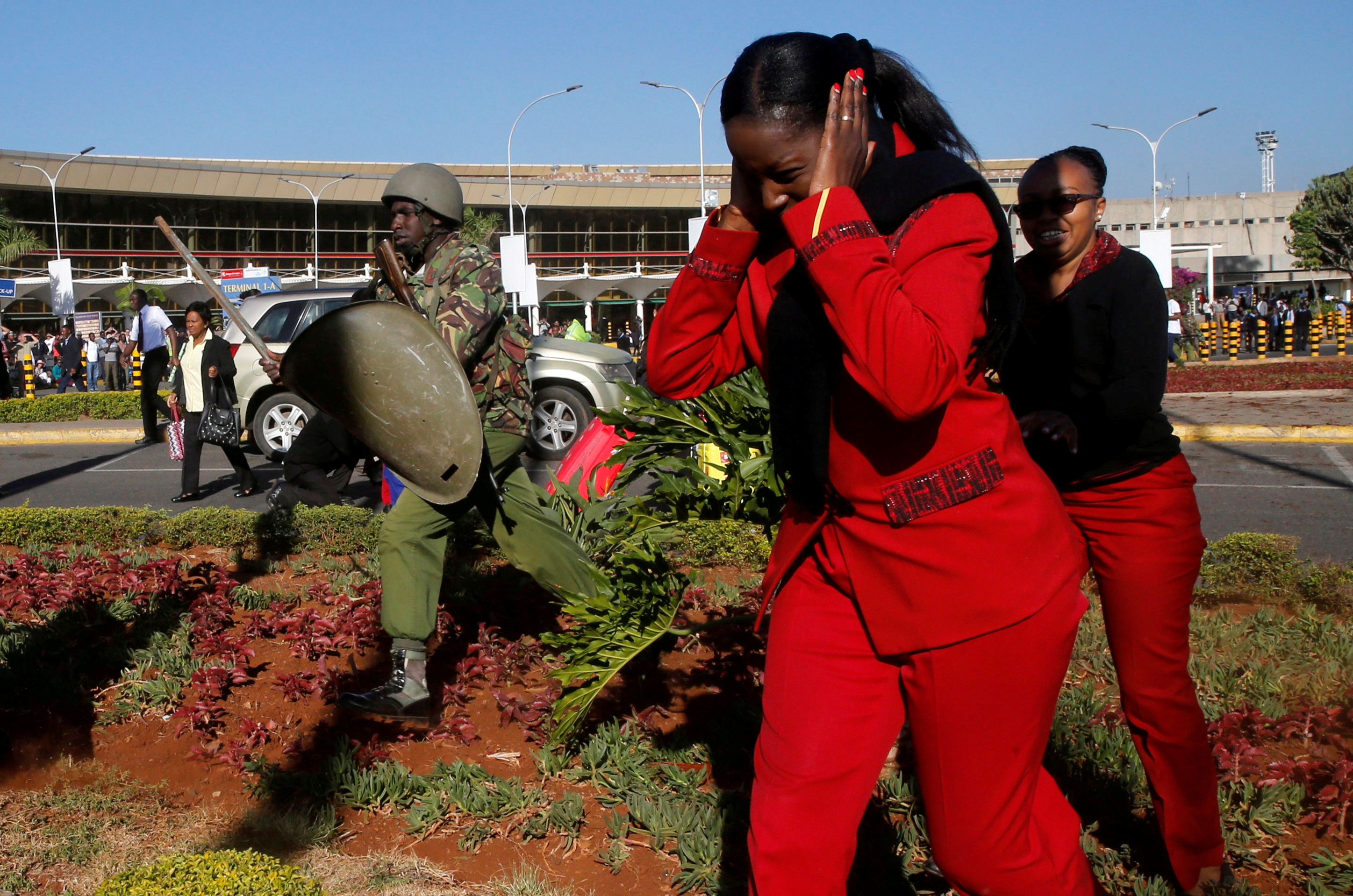 Kenya Airways workers are dispersed by riot police officers at the Jomo Kenyatta International Airport during a labour dispute that grounded flights near Nairobi, Kenya March 6, 2019.