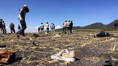 People walk at the scene of the Ethiopian Airlines Flight ET 302 plane crash, near the town of Bishoftu, southeast of Addis Ababa, Ethiopia March 10, 2019.
