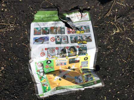 A passenger safety instruction card is seen at the scene of the Ethiopian Airlines Flight ET 302 plane crash, near the town of Bishoftu, southeast of Addis Ababa, Ethiopia March 10, 2019.