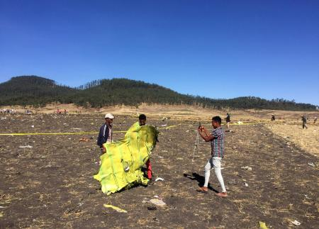 A civilian takes a photograph of the wreckage at the scene of the Ethiopian Airlines Flight ET 302 plane crash, near the town of Bishoftu, southeast of Addis Ababa, Ethiopia March 10, 2019.