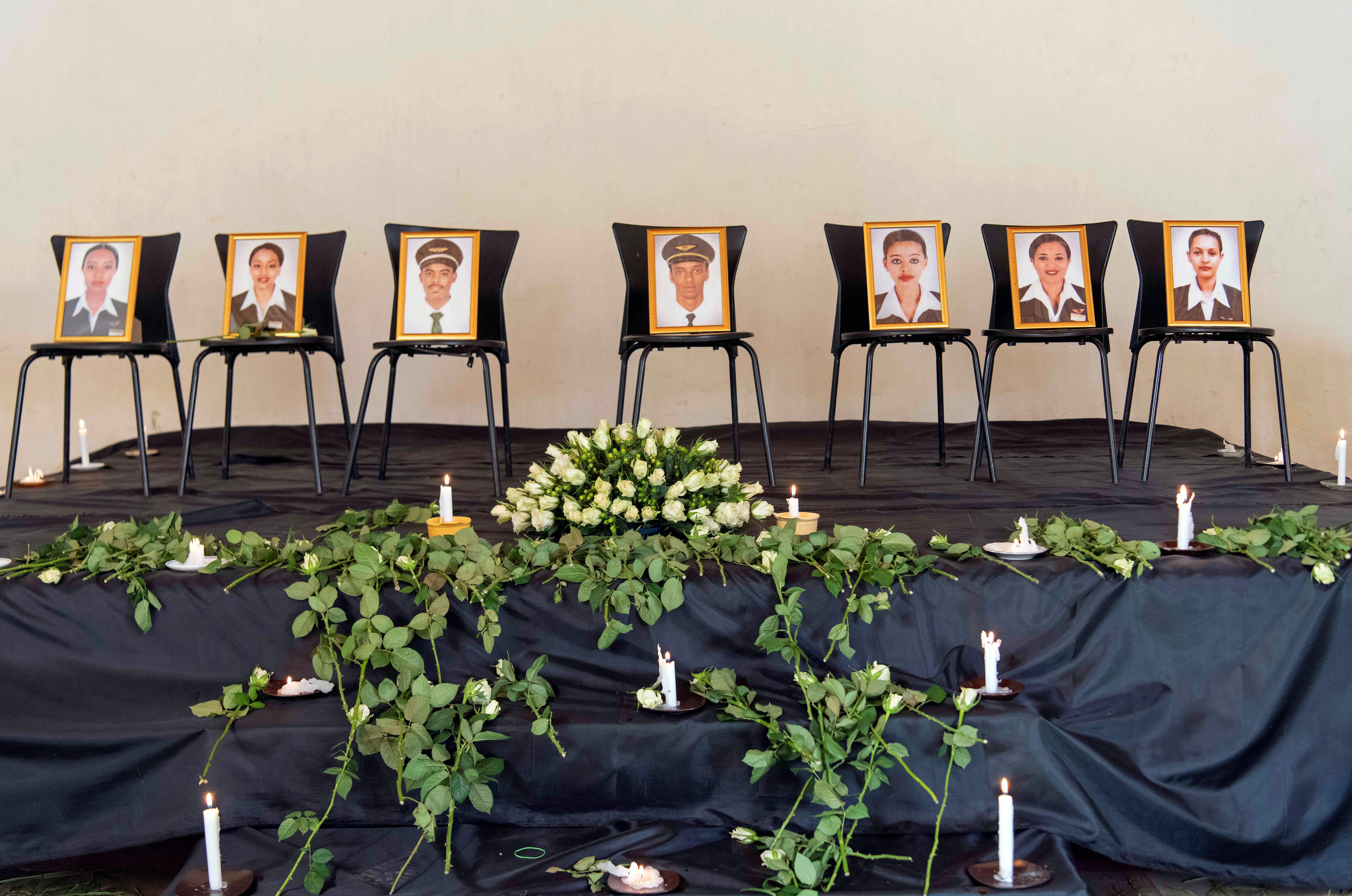 Photographs of crew members of the Ethiopian Airlines Flight ET 302 plane that crashed are seen during a memorial service by members of the Ethiopian Airline Pilots' Association in Addis Ababa, Ethiopia, March 11, 2019.