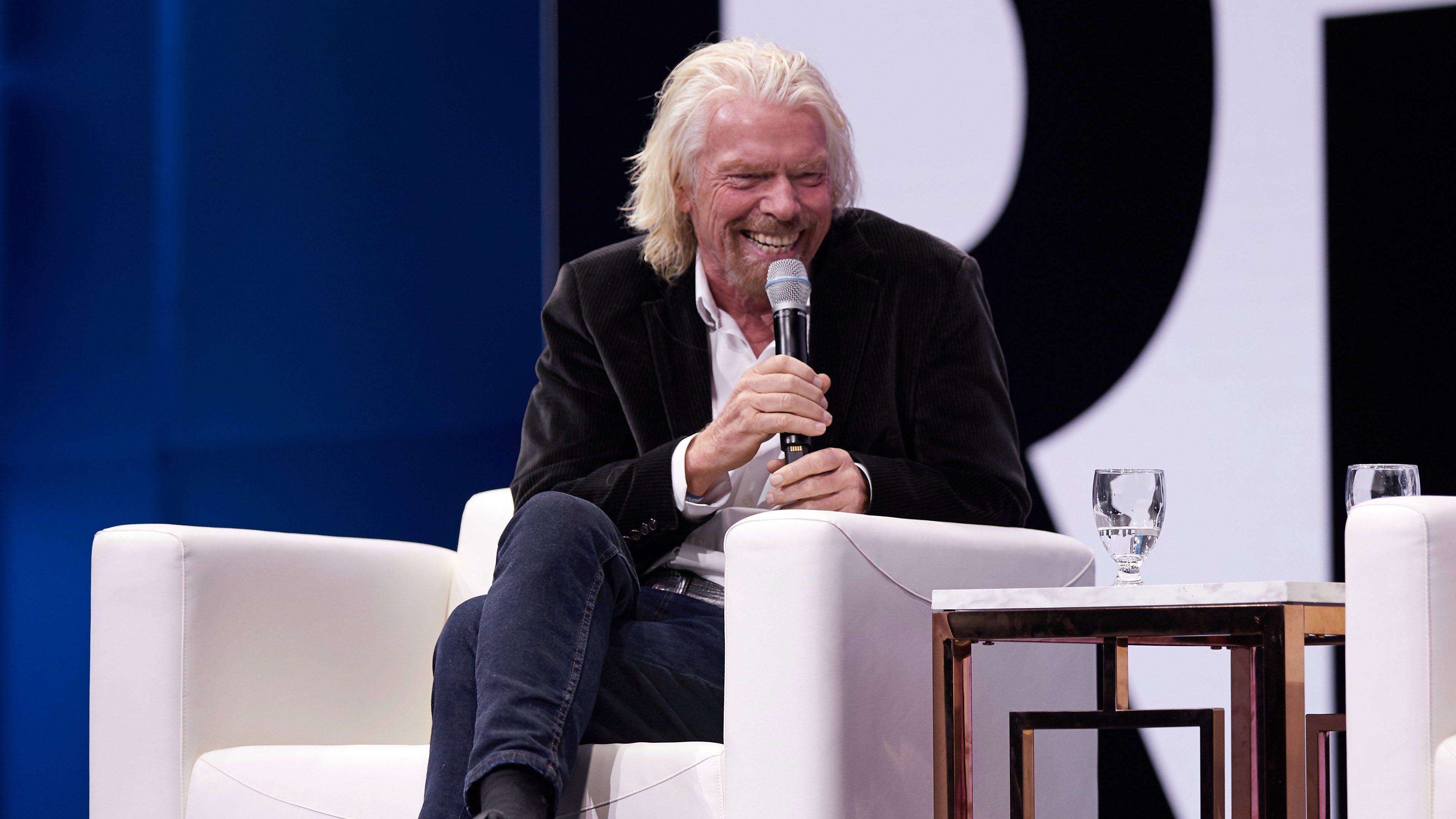 Richard Branson on stage from Qualtrics x4