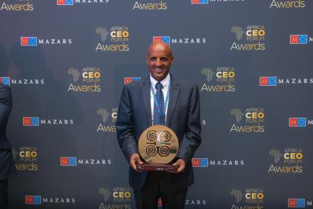 "Tewolde GebreMariam receiving the ""African Champion of the Year"" award at the Africa CEO Forum in Kigali"