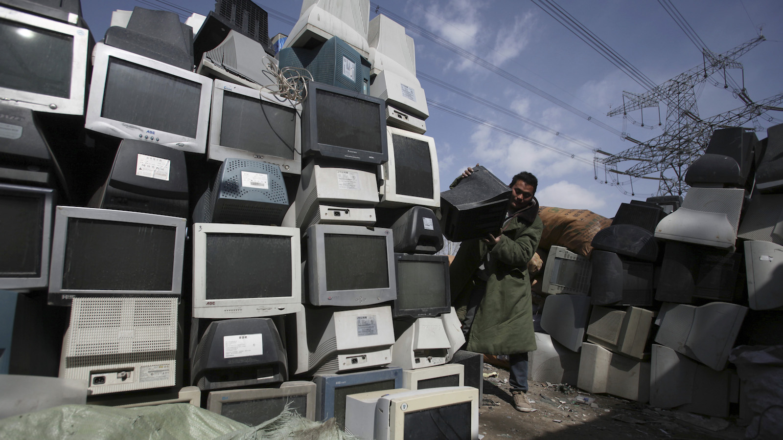 trash pile of old computers