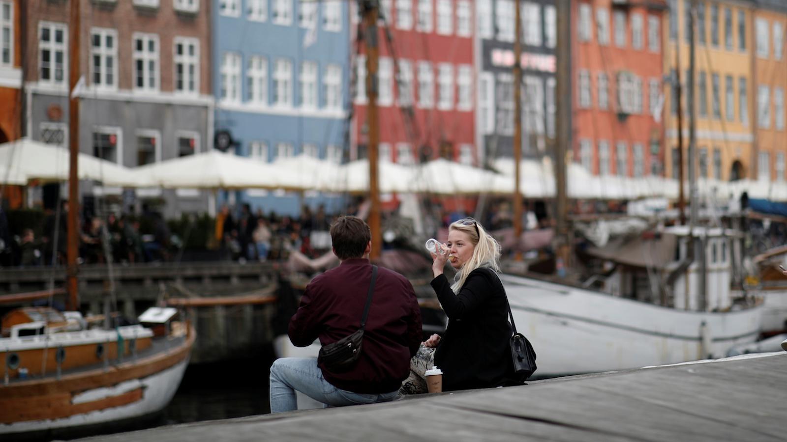people drinking on the copenhagen waterfront