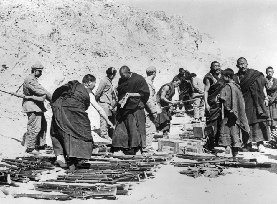 Tibetan monks, surrounded by Chinese soldiers