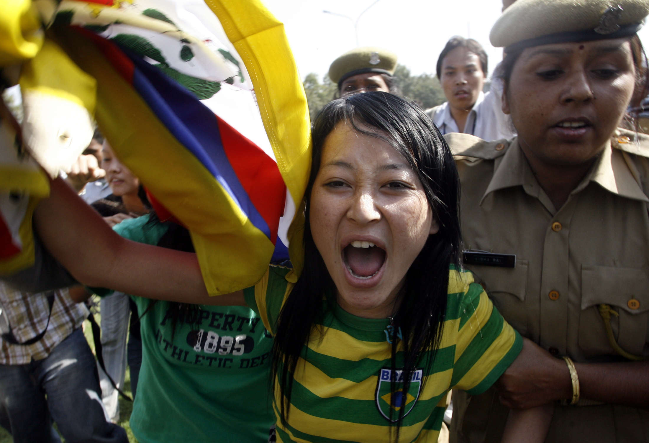 Police arrest a Tibetan exile outside the Chinese embassy in New Delhi