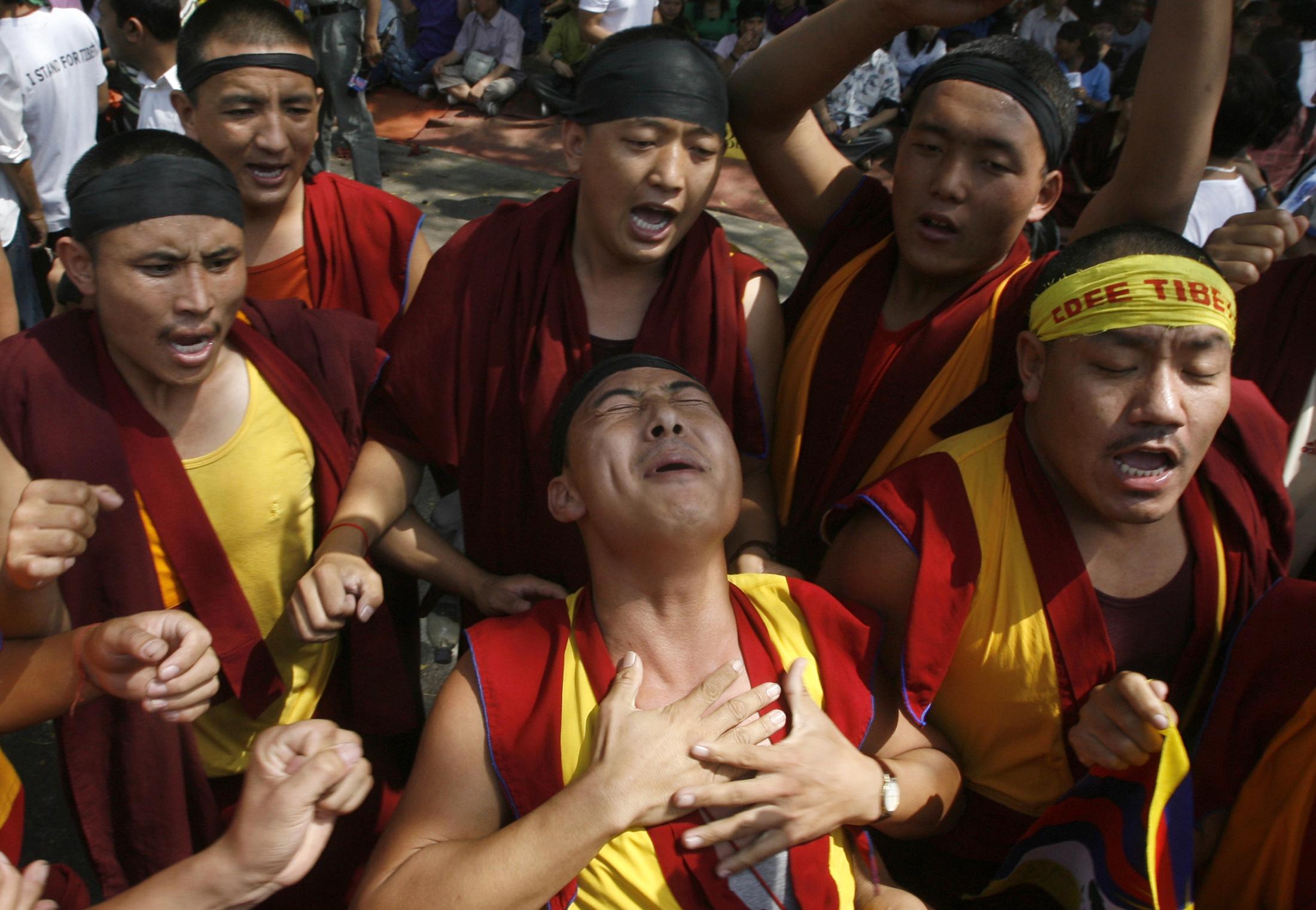 Tibetan monks shout slogans during a protest in New Delhi