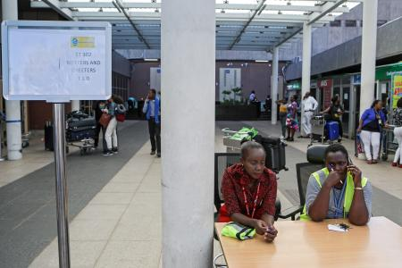 Airport staff wait for relatives at a help desk set up for the crashed Ethiopian Airlines flight ET 302, at the Jomo Kenyatta International Airport (JKIA) in Nairobi, Kenya, 10 March 2019. Ethiopian Airlines Boeing 737 Max 8 en route to Nairobi, Kenya, crashed near Bishoftu, some 50km outside of the capital Addis Ababa, Ethiopia, on 10 March 2019, the airline said in its statement. All passengers onboard the scheduled flight ET 302 carrying 149 passengers and 8 crew members, have died, the airlines says.