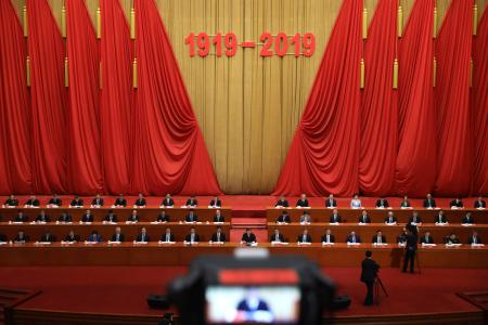 "Chinese President Xi Jinping, center and other top leaders attend a commemoration ahead of the 100th anniversary of the May 4 Movement at the Great Hall of the People in Beijing on Tuesday, April 30, 2019. The 100-year-old movement sought to overturn what was then called ""feudal"" thinking that opposed their calls for civil and women's rights. China's authoritarian Communist Party rulers now embrace the movement as a seminal moment in China's transition to a modern nation. (AP Photo/Ng Han Guan)"