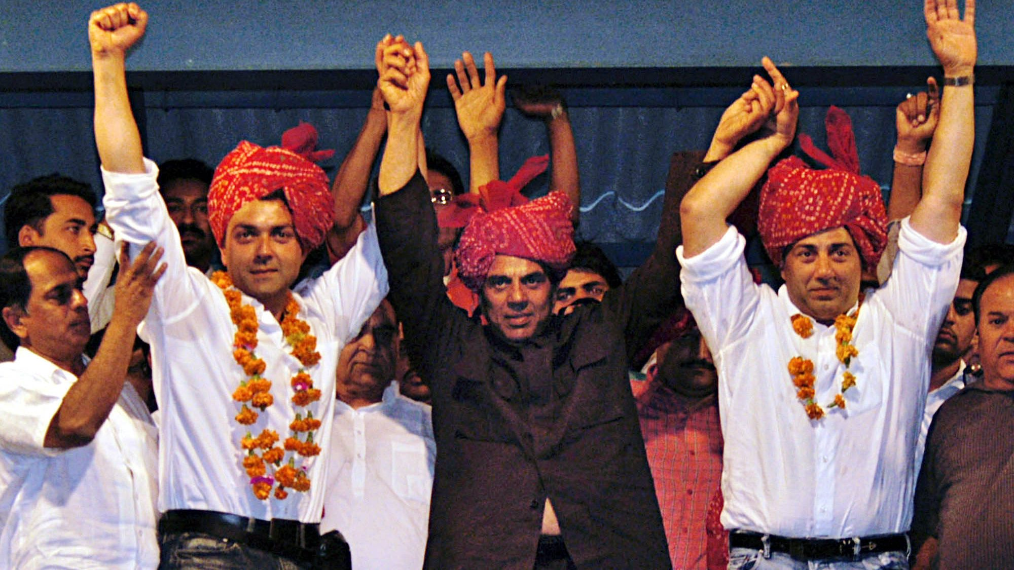 Image result for sunny deol with dharmendra campaigning