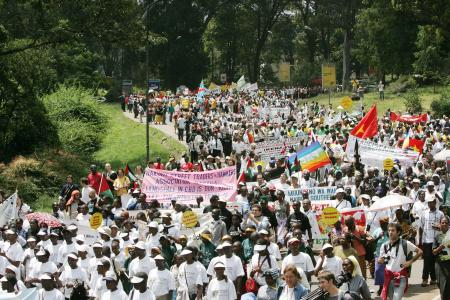 People march during the opening of the World Social Forum, Saturday, Jan. 20, 2007 in the Kenyan capital, Nairobi. More than 80,000 people gathered for an annual anti-capitalist conference in Kenya's capital on Saturday, hoping to network with other activists and protest global policies they say hurt the poor.